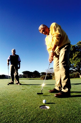 Two men playing golf : Stock Photo