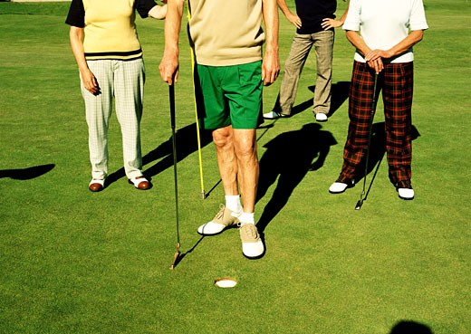 Feet of a group of people playing golf : Stock Photo