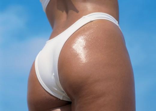 Low angle view of a young woman wearing a bikini : Stock Photo