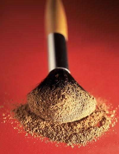 Stock Photo: 1491R-1134160 Close-up of a make up brush and powder
