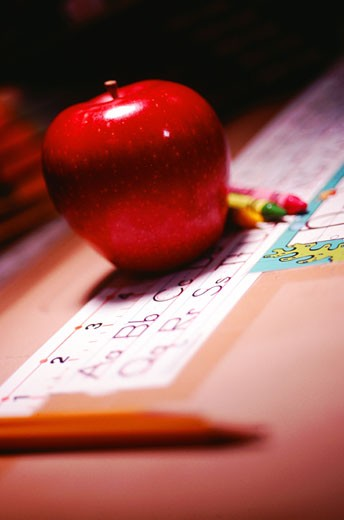 Apple with crayons, close-up : Stock Photo