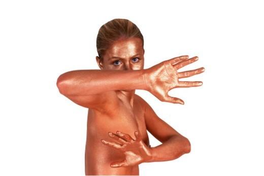 metallic woman defending herself : Stock Photo