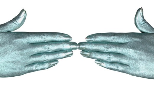 two metallic hands pointing at each other : Stock Photo
