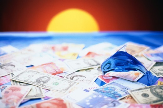 money and rising sun : Stock Photo