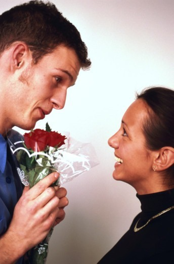 man giving woman bunch of flowers : Stock Photo