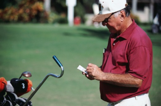 Stock Photo: 1491R-1143967 golf player writing down score