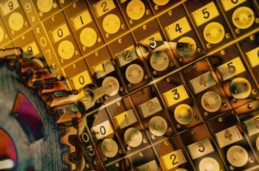 Golden numbers and cogwheel (Digital Composite) : Stock Photo
