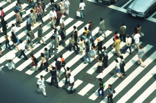 Crowds of people pedestrian crossing, high angle view : Stock Photo