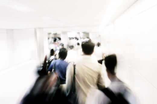 Stock Photo: 1491R-1145248 People on escalator at airport (blurred motion)