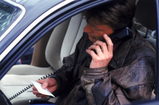 Stock Photo: 1491R-1146218 man in car making phone call