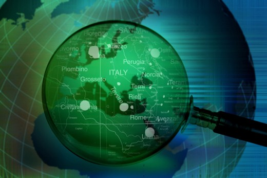 World map viewed through a magnifying glass  (Digitally Generated) : Stock Photo
