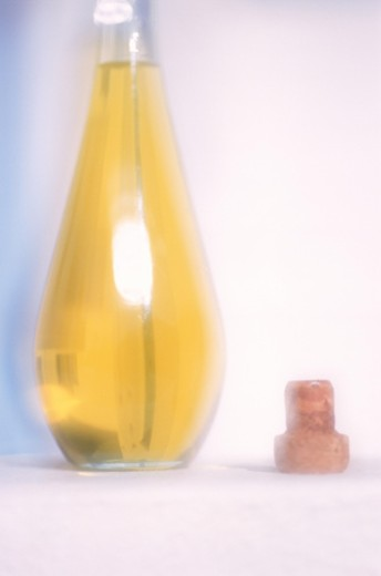 Stock Photo: 1491R-1148419 Cooking oil in bottle with cork beside, close-up
