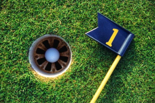 Stock Photo: 1491R-1150113 golf ball in hole