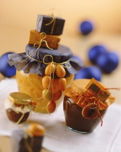 Kumquat gift with savory sauce in jar : Stock Photo