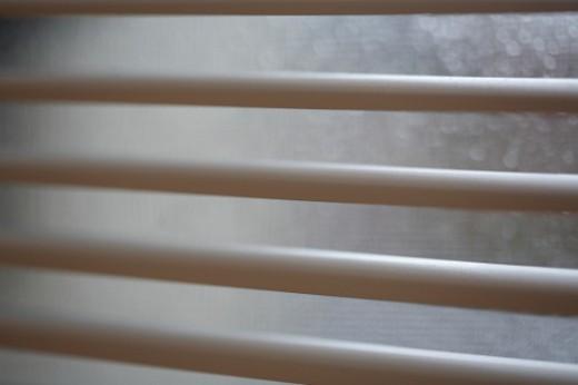 Slats of venetian blinds on window, close-up : Stock Photo