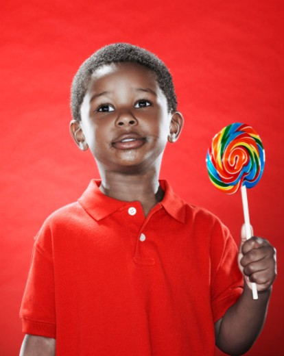 Stock Photo: 1491R-1151776 Boy (2-4) holding lollipop, close-up