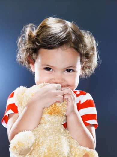Girl (1-3) holding teddy bear, smiling : Stock Photo