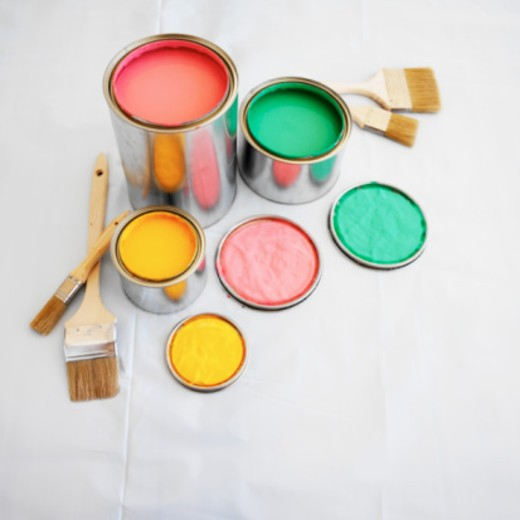 open paint cans and paint brushes on the floor : Stock Photo