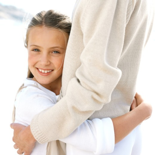 portrait of a daughter hugging her mother : Stock Photo