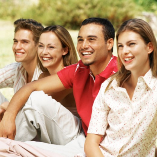 portrait of two young couples sitting outdoors : Stock Photo
