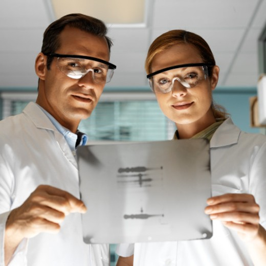 portrait of two doctors holding an x-ray : Stock Photo