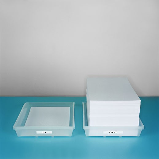 large stack of paper lying in an out tray : Stock Photo