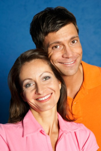 Stock Photo: 1491R-1156935 Portrait of a mid adult couple smiling