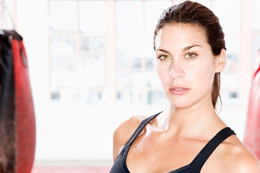 Female boxer at the gym : Stock Photo