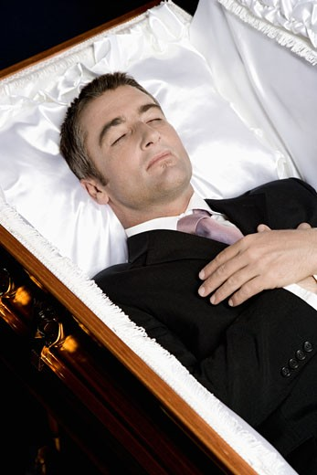 Deceased man lying in a coffin : Stock Photo