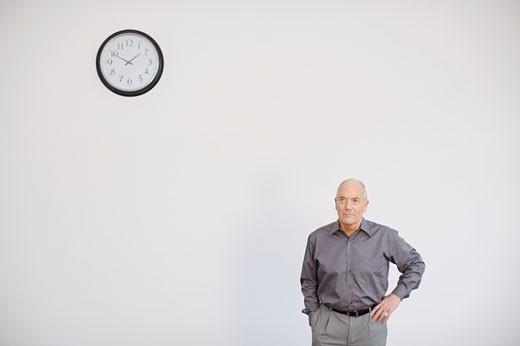 Stock Photo: 1491R-1158179 Man posing with clock