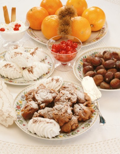 Stock Photo: 1491R-116125 high angle view of assorted homemade cookies served on a table with fresh fruits