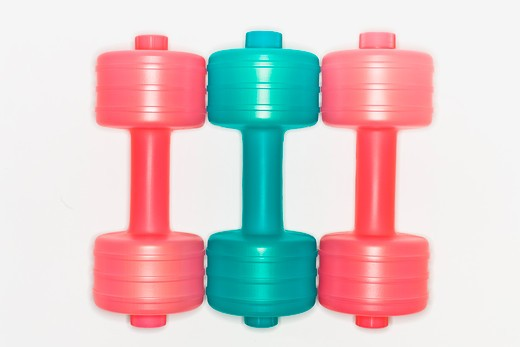 Color dumbbells form a line : Stock Photo