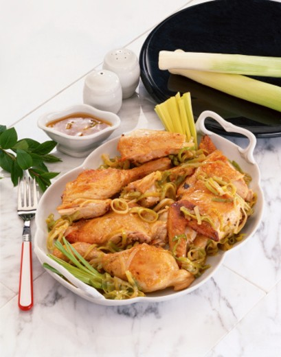 high angle view of a chicken dish served with dip and celery sticks : Stock Photo