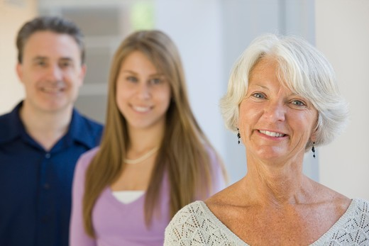 Stock Photo: 1491R-1162174 Smiling mature woman, teen and man