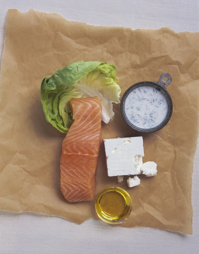 Lettuce, salmon, feta cheese, olive oil, dressing : Stock Photo
