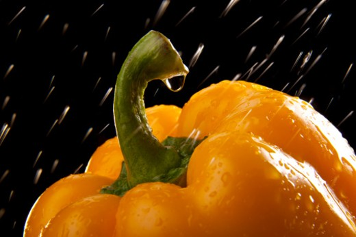 Stock Photo: 1491R-1163132 Water droplet on a yellow capsicum.