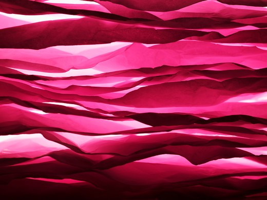 Stock Photo: 1491R-1163189 Layered sheets of crumpled pink paper.