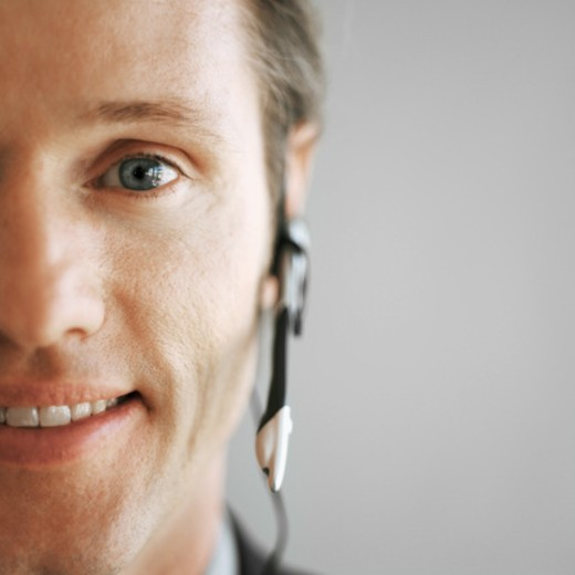 Stock Photo: 1491R-116331 Close-up of a young businessman wearing a telephone headset