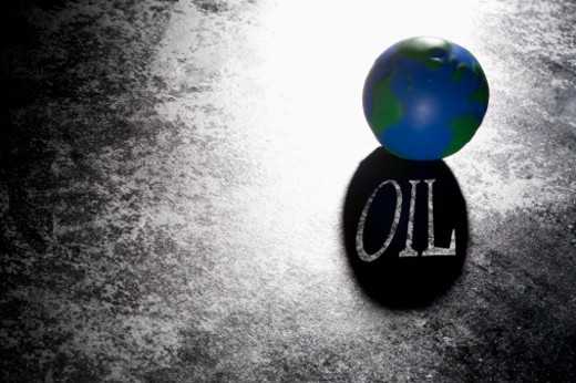 Still life of oil on surface with world globe : Stock Photo
