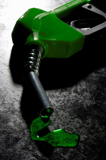 Green gas pump leaking gas : Stock Photo