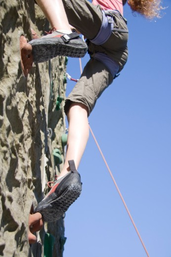 Stock Photo: 1491R-1166107 A young girl scaling a climbing wall