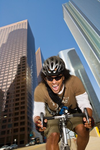 Messenger riding fast through a downtown area. : Stock Photo