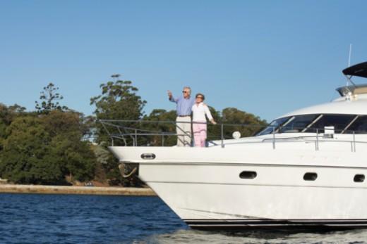 Stock Photo: 1491R-1168138 Australia, Sydney, Sydney Harbour, couple on bow of yacht
