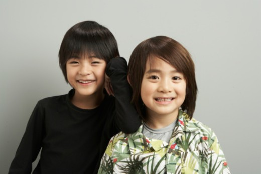Stock Photo: 1491R-1168592 Two brothers (6-9) smiling, portrait