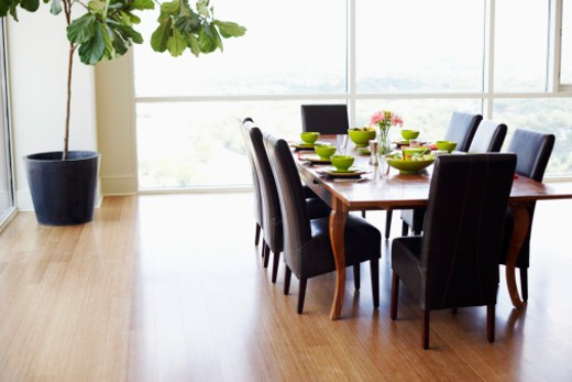 Dining table with empty chairs in a dining room : Stock Photo