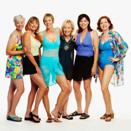 Portrait of a group of mature women standing together and smiling : Stock Photo