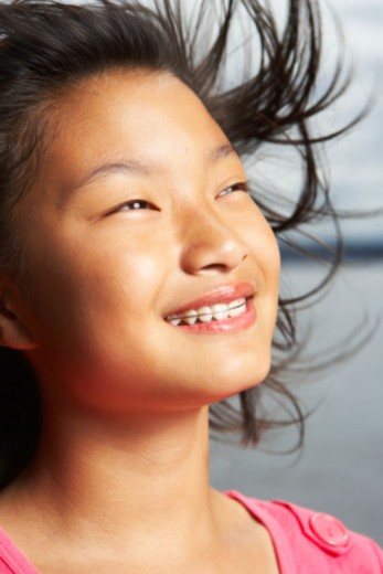 Stock Photo: 1491R-1170132 Girl (9-11) outdoors, smiling, close-up