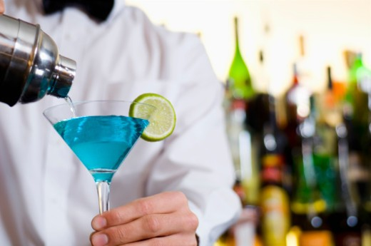 Barman pouring a cocktail : Stock Photo