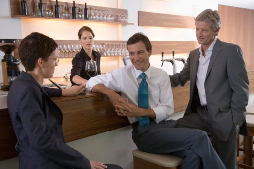 Businesspeople at bar : Stock Photo