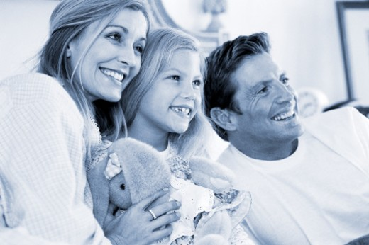 Stock Photo: 1491R-117041 black and white view of a family sitting together